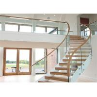 China Solid Wood Apartment Stairs Carbon Steel Beam With Clear Tempered Glass Railing on sale