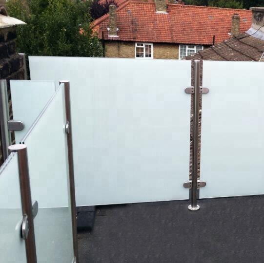 white laminated balcony railing glass cost.jpg