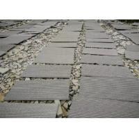 China Hainan Black Lava Sands Blasted Bluestone Black Dark Basalt Flamed Grooved Natural Stone Tiles Slabs for sale
