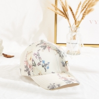 Wholesale Six Panels Metal Patch Curve Brim Baseball Cap Floral Pattern from china suppliers